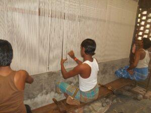 skilled weavers weaving tibetan wool rug